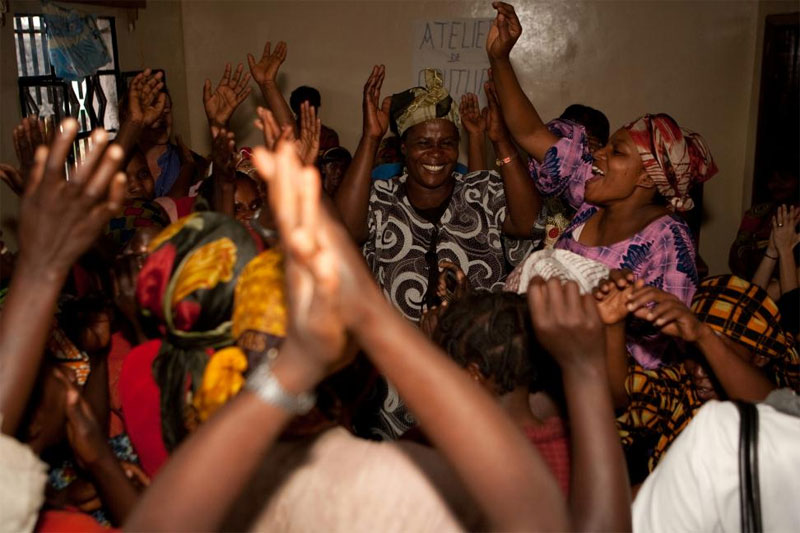 photo african women hands and arms in the air in celebration