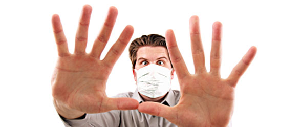 stock photo man in hospital mask with hands up