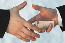 stock photo hands passing money in gesture