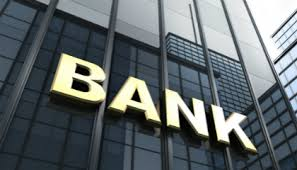 stock photo illuminated bank sign on exterior glass office building