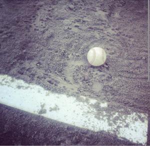 stock graphic baseball next to pitchers plate