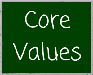 graphic core values written in chalk on green chalkboard