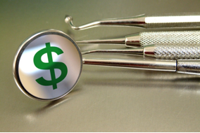 stock photo dental tools with dollar sign on mirror
