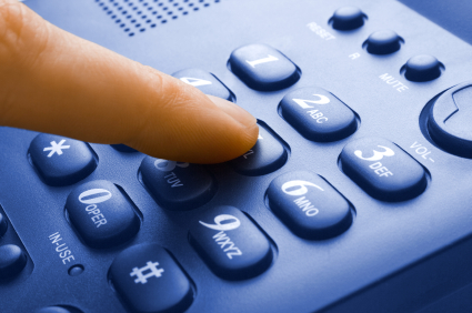 finger with blue telephone keypad - communication concept
