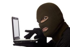 stock photo man in mask at computer
