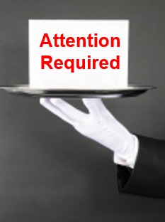 graphic attention required sign on silver platter held by white gloved hand