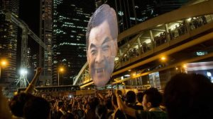 editorial photo cy leung face on building