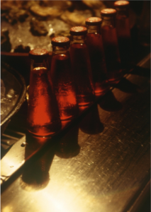 photo beer bottles on factory conveyor belt