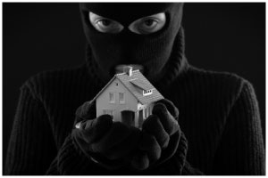 stock photo man in mask holding house in hands grayscale