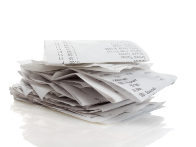 stock photo stack of receipts piled high on white background