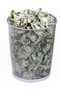stock photo wire waste basket filled with money