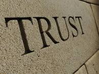 stock graphic trust carved into stone
