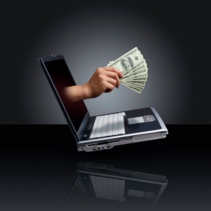 stock photo money in hand coming out of compute screen